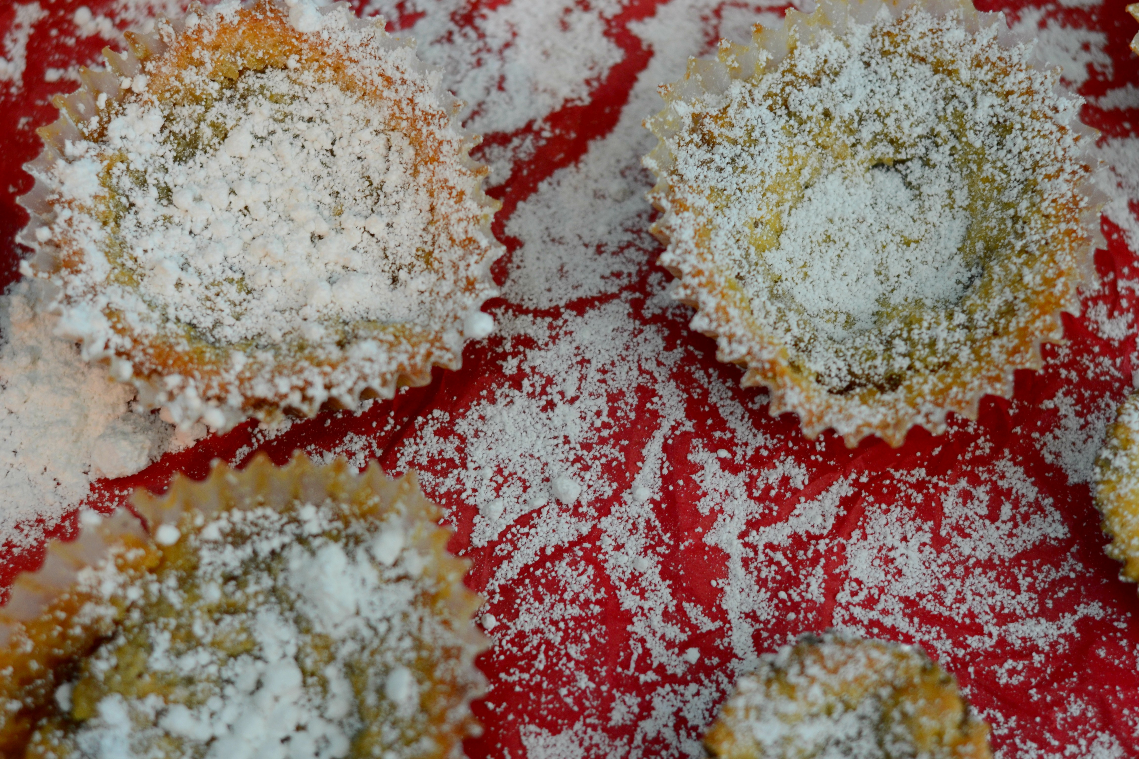 overhead view of miniature crack pies sprinkled with powdered sugar