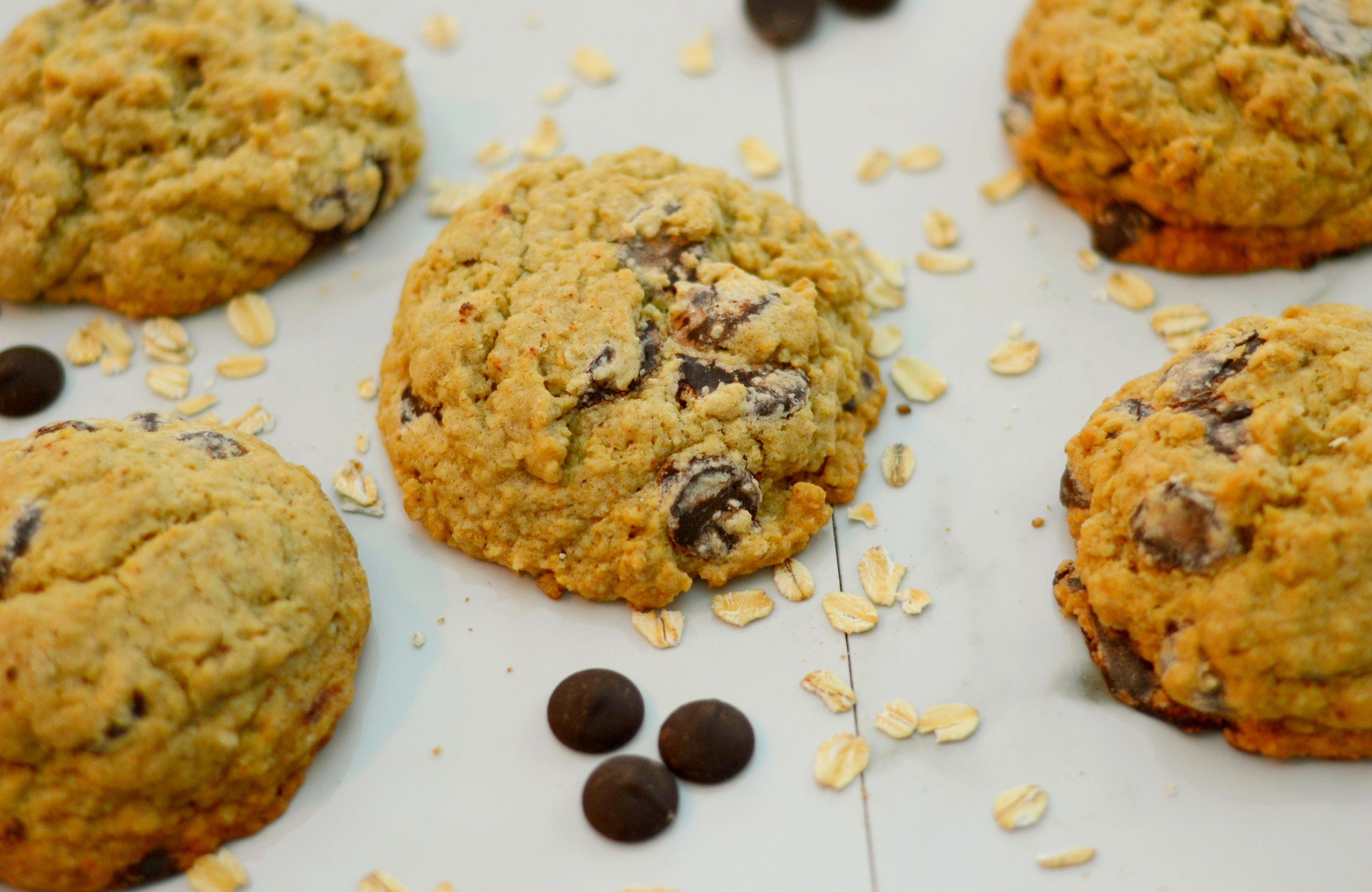 Overhead View of Giant Chocolate Chip Oatmeal Cookies on a White Background