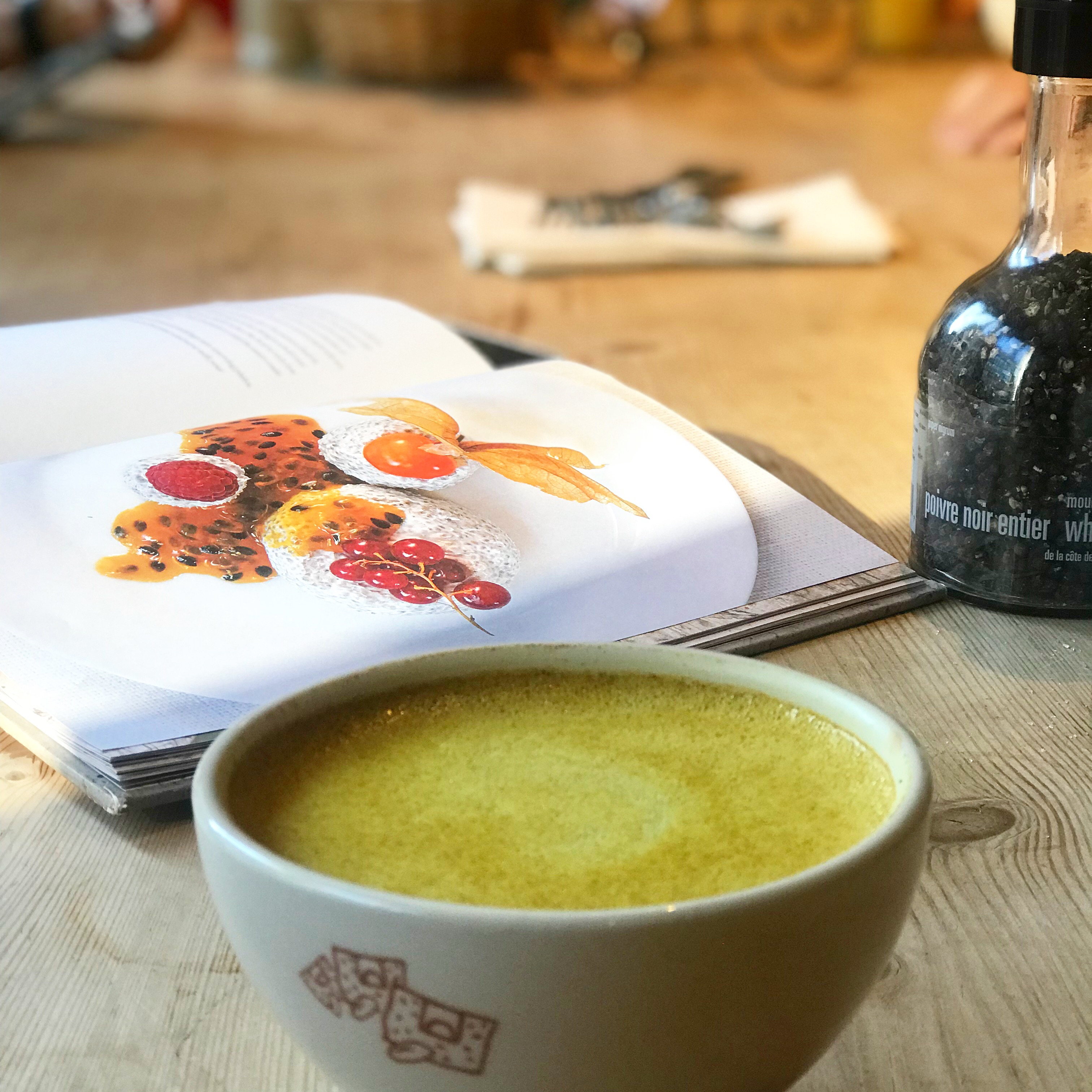 tumeric latte with an open cookbook in the background