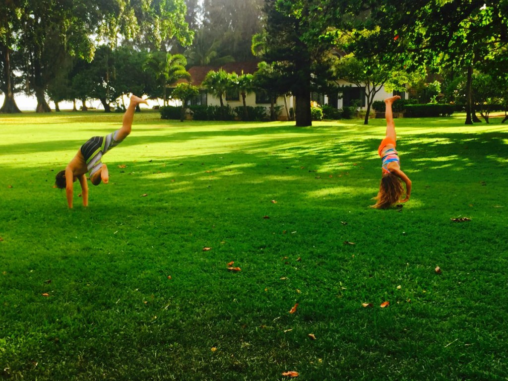 having fun on the lawn at Waimea Plantation Cottages