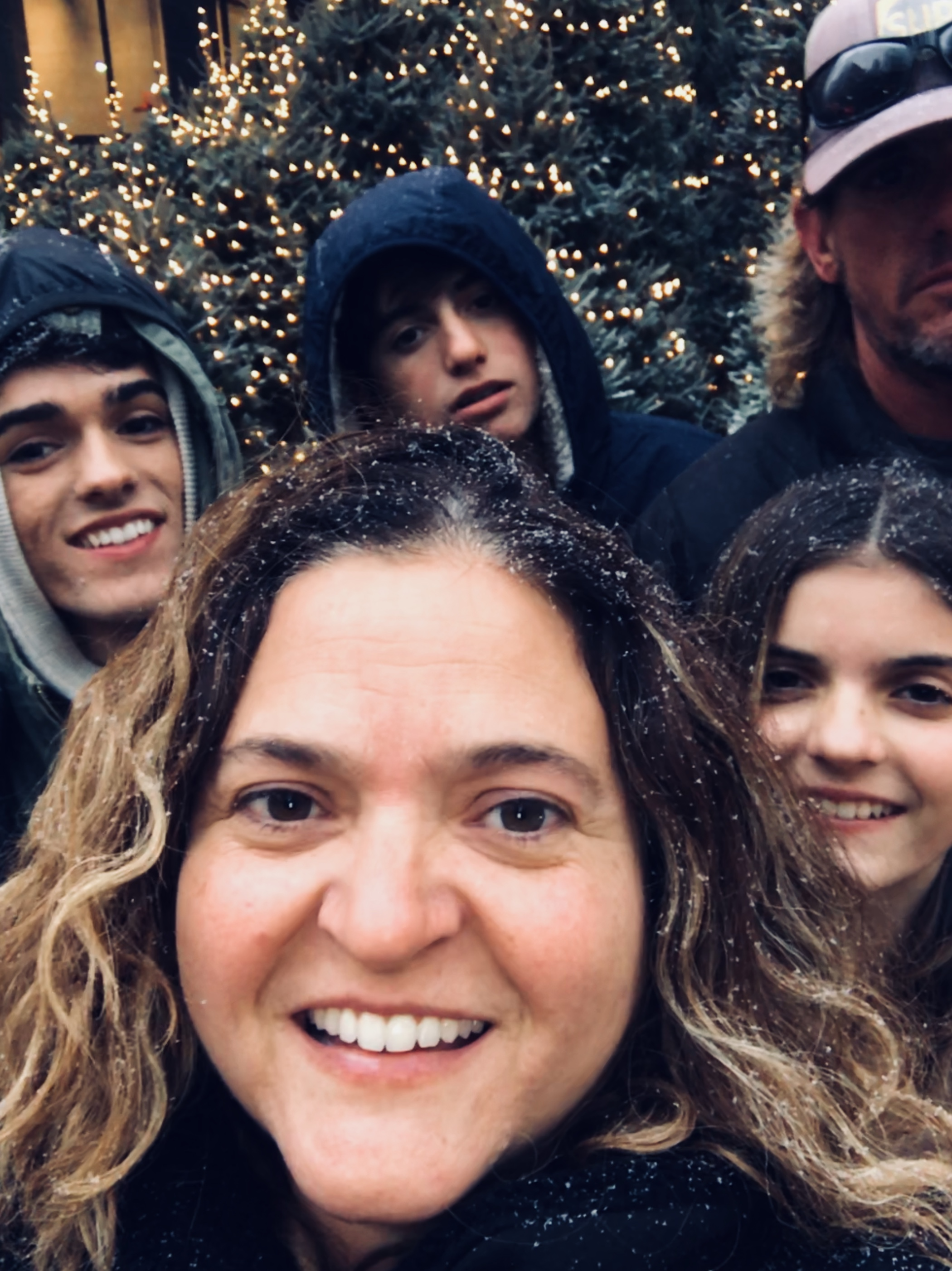family of five selfie in New York City in the snow