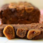 close up of a slice of chocolate fig banana bread