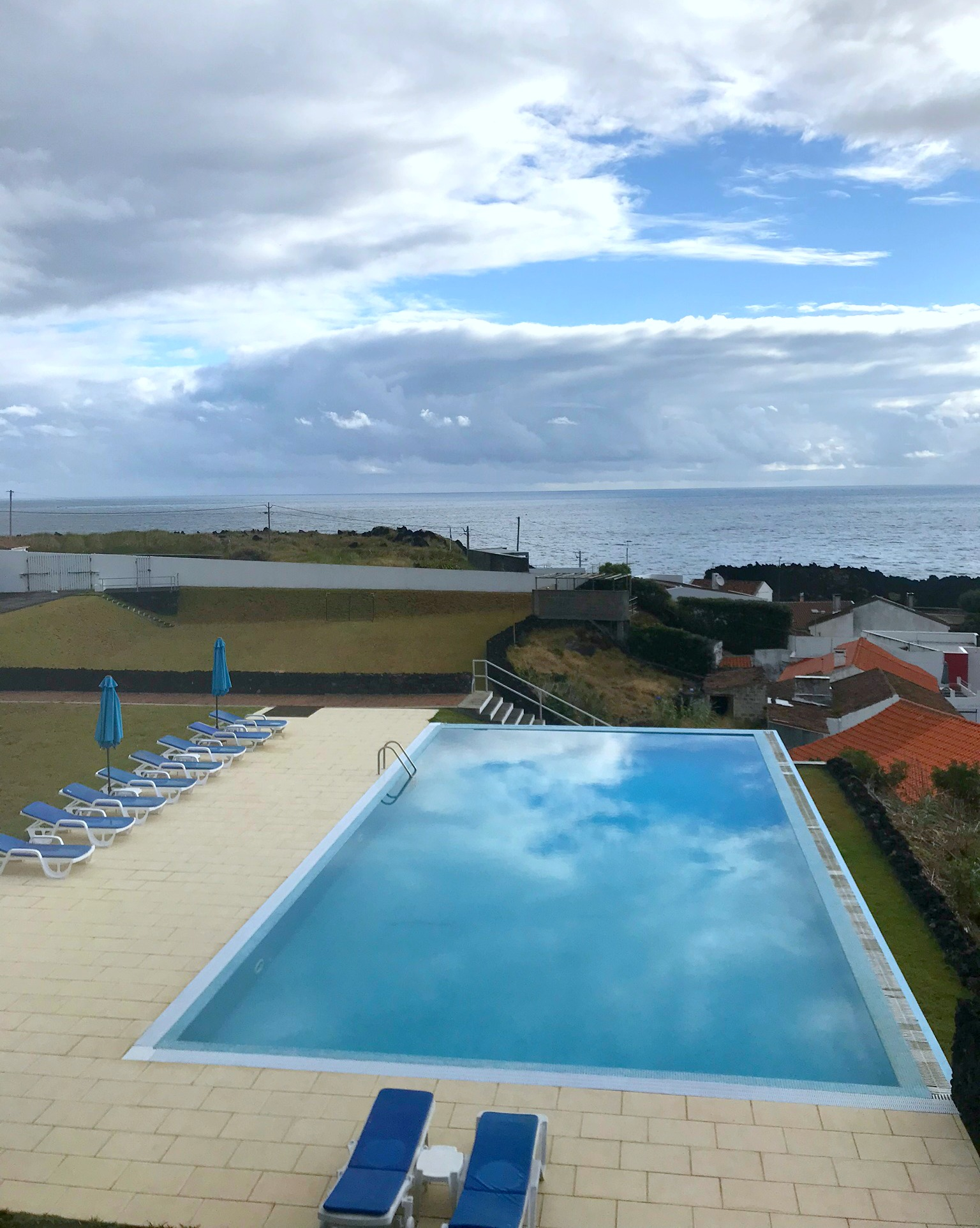 view from lanai overlooking the infinity pool and the Azores