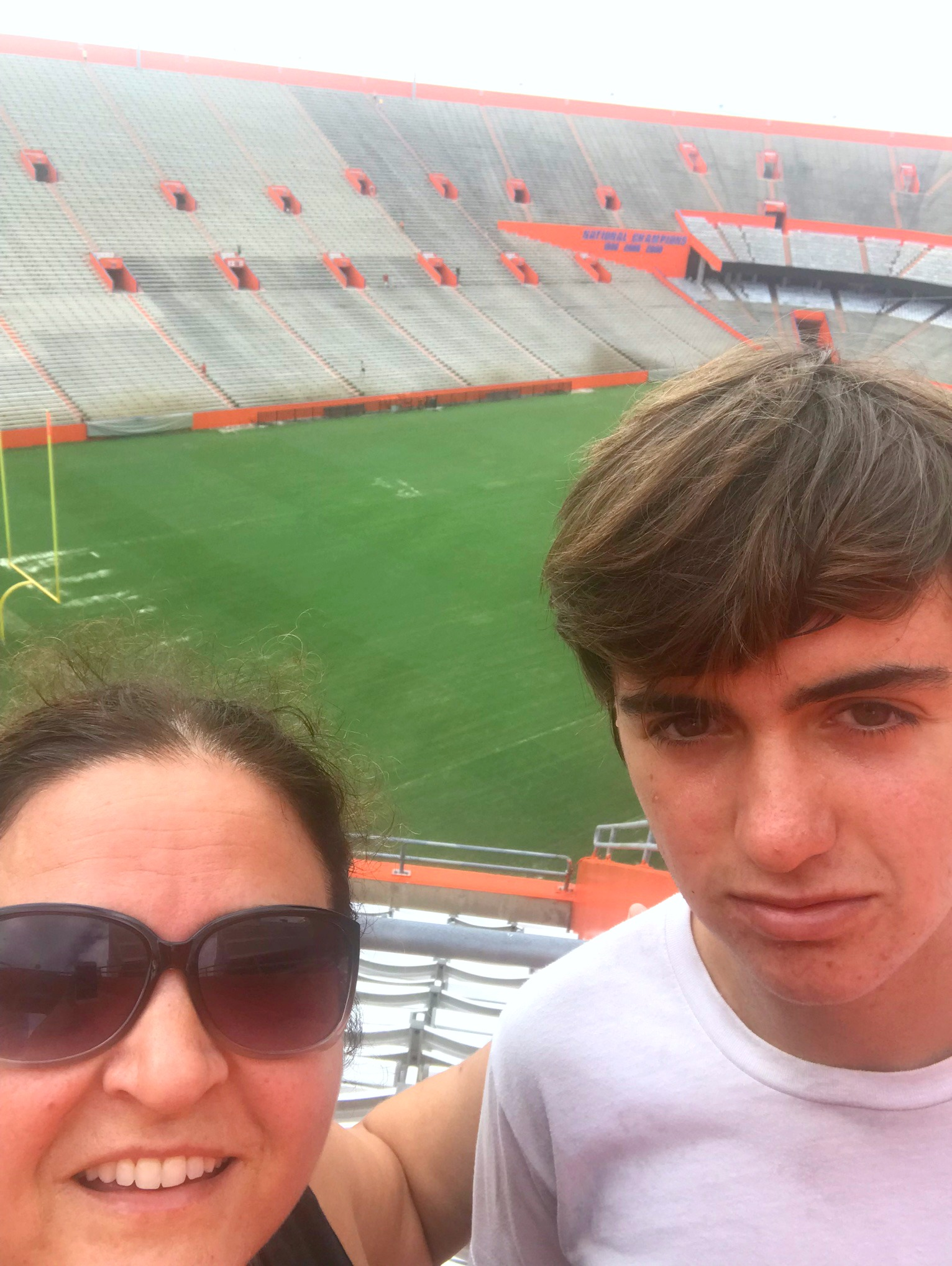 mom and son tired after running the stadium stairs at Gator Stadium University of Florida