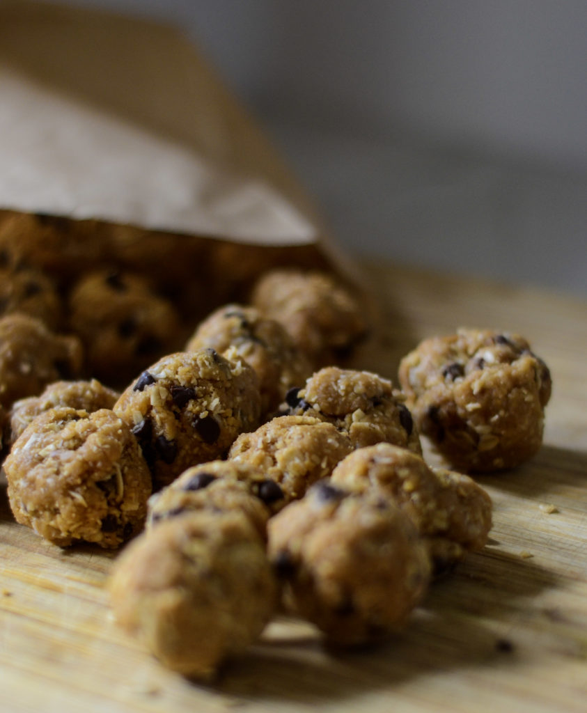 peanut butter protein balls in brown paper bag