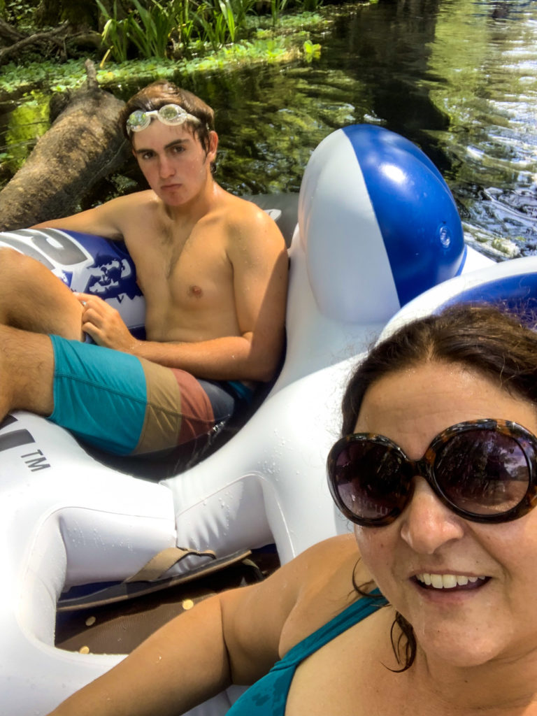 mom and son tubing down the Ichtucknee Springs river in Florida